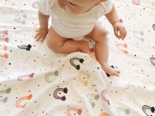 Rainbow muslin baby swaddle blanket Charlie Rowan Designs